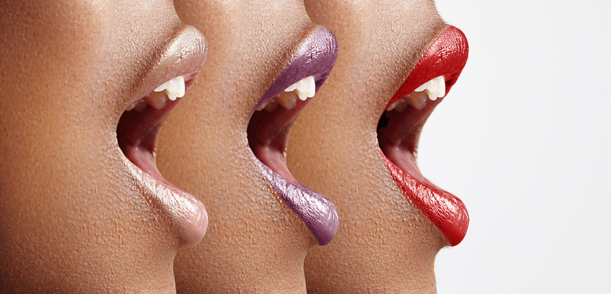three woman's profiles with different lip color ** Note: Shallow depth of field