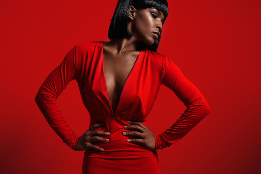 black woman in red on a red