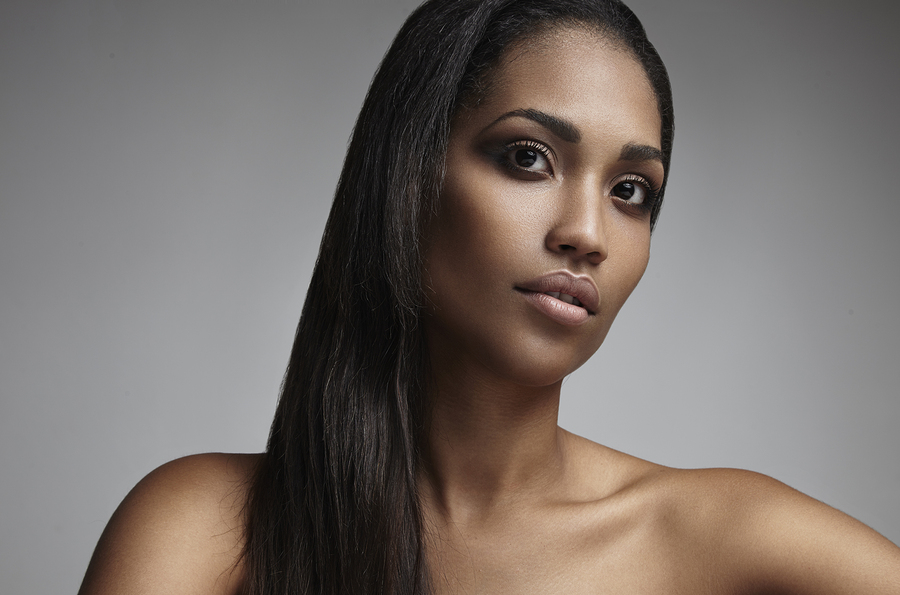 an elegant black woman with straight hair